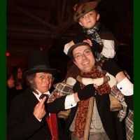 2 of 25 - Bob Cratchit and Tiny Tim with Ebenezer Scrooge. Photo by Raymond Van Tassel; all rights reserved.