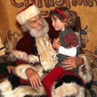 5 of 25 - Father Christmas meets good children at the Dickens Christmas Fair. Photo by Raymond Van Tassel; all rights reserved.