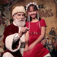 13 of 24 - Father Christmas holds court daily to hear the wishes of good children. Photo by Raymond Van Tassel; all rights reserved.